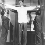 Henry Hite, the Chicago Giant, Is Measured for His Shirts Photo