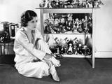 Evelyn Brent at Home with Her Collection of Perfume Containers, 1930 Photo
