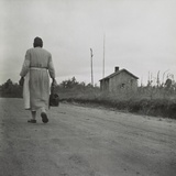 African American Midwife Carrying Her Medical Bag on a Dirt Road in Georgia Photo