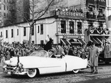 Newly Inaugurated President Dwight Eisenhower Waves to Crowds from an Open Car Photo