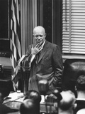 President Eisenhower Listening to a Reporter's Question at a Press Conference Photo
