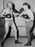 Former Heavyweight Champion, Jack Johnson, Left, in Fighting Pose with Steve Dudos Photo