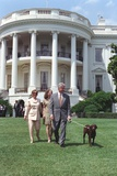 President Bill Clinton, Hillary and Chelsea Clinton, and Buddy the Dog on the South Lawn Photo