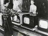 At the End of the Assembly Line, Inspected Televisions are Packaged in an American Factory Photo