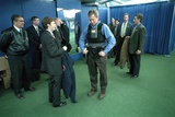 President George W. Bush Puts on a Vest before the First Pitch in Game 3 of the World Series Photo