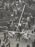 Brown University Students Tear Down the Goal Posts in Celebration of a 7-6 Win over Columbia Photo