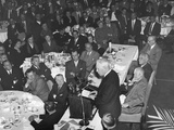 President Eisenhower Listens as Chief Justice Earl Warren Speaks at a Prayer Breakfast Photo