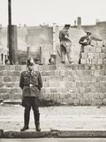 West Berlin Policeman Stands before the Concrete Block Wall Dividing East and West Berlin Photo