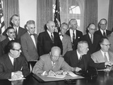 President Eisenhower Initialing the First Agreement for the Peaceful Use of Atomic Energy Photo