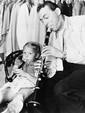 Jazz Musician Woody Herman Playing His Clarinet While His Daughter Ingrid Plays a Plastic Flute Foto