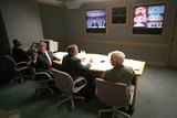 President George W. Bush in a Multiscreen Video Conference at Offutt Air Force Base, Sept. 11, 2001 Photo