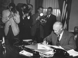 President Eisenhower Signing a Resolution to Promote Peace and Stability in the Middle East Photo
