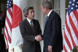President George W. Bush Shakes Hands with Prime Minister Junichiro Koizumi of Japan. Sept. 25 Photo
