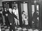 Harry Truman Walks Past Reporters in the Telephone Booths the Old State Department Building Photo