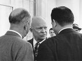 Candid Portrait of President Eisenhower in Conversation with Unidentified Men on March 31, 1955 Photo