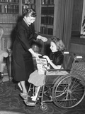 First Lady Mamie Eisenhower with a Girl During the Yearly Muscular Dystrophy Fund Raising Drive Photo