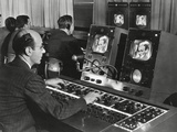 Television Studio Engineer Gets Several Views of the Image and Use the Complicated Set of Dials Photo