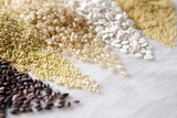 Grain Still Life: Brown Rice, Millet, Rice, Pearl Barley, Amaranth Photographic Print by  Amana Images Inc.