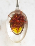 Saffron Threads in Oil on a Spoon Photographic Print by Nikolai Buroh