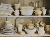 White Tableware and Table Cloths on a Kitchen Shelf Photographic Print by Ellen Silverman