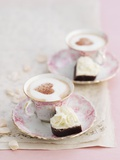 Petit Fours and Cappuccino Decorated with Cocoa Powder Hearts Photographic Print by Gareth Morgans