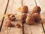Walnuts on a Wooden Background Photographic Print by Matthias Hoffmann
