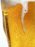 Foam Pouring over Edge of Glass of Light Beer Photographic Print by Brenda Spaude