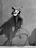 Troubadour - Uses of a Penny Farthing Borrowed from the Troubadour Premium Photographic Print by Ken Russell