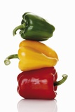 One Red, One Yellow and One Green Pepper, Stacked Photographic Print by Dieter Heinemann