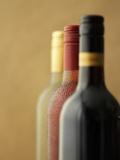 Three Bottles of Wine: Red Wine, Rose Wine and White Wine Photographic Print by Ian Garlick