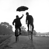 Chauffeur and Master - Uses of a Penny Farthing Borrowed from the Troubadour Premium Photographic Print by Ken Russell