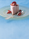 A Slice of Strawberry Yoghurt Torte on a Glass Plate Photographic Print by  Condé Nast Collection
