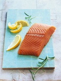 Wild Salmon Fillet with Lemon and Rosemary Photographic Print by Matthias Hoffmann