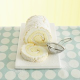 Lemon Meringue Roulade with Icing Sugar, a Slice Cut Photographic Print by Dave King