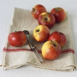 Fresh Apples on Linen Cloth with Peeler Photographic Print by Michael Paul