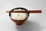 Boiled Basmati Rice in a Red Bowl with Chopsticks Photographic Print by Peter Rees