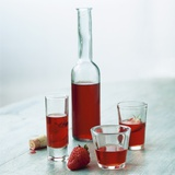 Strawberry Liqueur in Bottle and Three Different Glasses Photographic Print by Michael Paul