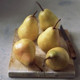 Five Yellow Pears on a Chopping Board Photographic Print by Michael Paul