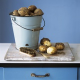 Organic Potatoes in Bucket and on Chopping Board; Brush; Knife Photographic Print by Michael Paul