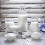 Various Dairy Products in Front of Window Frame Photographic Print by Peter Rees