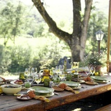 An Outdoor Table Setting with a Vegetarian Meal Photographic Print by Renée Comet