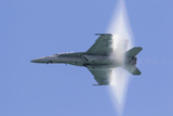 A U.S. Navy FA-18F Super Hornet Flies by at High Transonic Speed Photographic Print by  Stocktrek Images