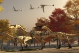 Three Eudimorphodons Fly Above a Group of Coelophysis in an Autumn Forest Art by  Stocktrek Images