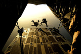 U.S. Air Force Pararescuemen Jump from an Hc-130 Aircraft Off the Coast of Djibouti Photographic Print by  Stocktrek Images
