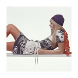 Model, Reclining on Her Elbows, Wearing a Shirt Dress in a Navy and White, Japanese-Inspired Print Regular Giclee Print by Gianni Penati