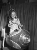 Little Boy on Spaceship Ride Photographic Print