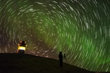 Star Trails and Aurora Borealis or Northern Lights, Iceland Photographic Print by  Arctic-Images
