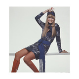 Model, Sitting on Bench, Wears a Blue and White Snake-Print T-Shirt Style Dress Regular Giclee Print by Gianni Penati