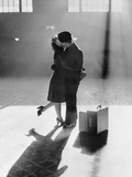 Couple Kissing in Train Station Photographic Print