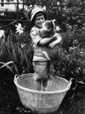 Girl (6-7 Years) Embracing Her Cat Photographic Print